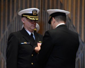 BANGOR, Wash. (Apr. 21, 2015) Cmdr. Jeffery Smith, outgoing commanding officer of USS Kentucky (SSBN 737), left, is presented the Meritorious Service Medal by Capt. Brian Humm, commodore of Submarine Squadron 19, right, during a change of command ceremony at the Naval Base Kitsap - Bangor base chapel. (U.S. Navy photo by Mass Communication Specialist 1st Class Kenneth G. Takada/Released)