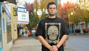 "Bremerton rapper David Olivas stands outside the Roxy Theater in Bremerton. Many of Olivas's fans believe Adam Sandler ripped off his song ""Phone, Keys, Wallet, Weed"" in a Netflix special."
