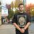 """Bremerton rapper David Olivas stands outside the Roxy Theater in Bremerton. Many of Olivas's fans believe Adam Sandler ripped off his song """"Phone, Keys, Wallet, Weed"""" in a Netflix special."""